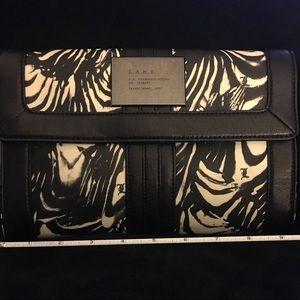 L.A.M.B by Gwen Stefani // Newcombe Clutch Handbag